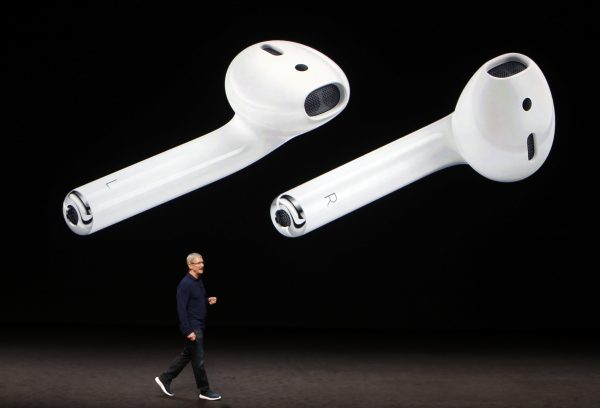 AirPods are displayed as Apple Inc CEO Tim Cook makes his closing remarks during an Apple media event in San Francisco, California, U.S. September 7, 2016.  REUTERS/Beck Diefenbach - RTX2OJUN
